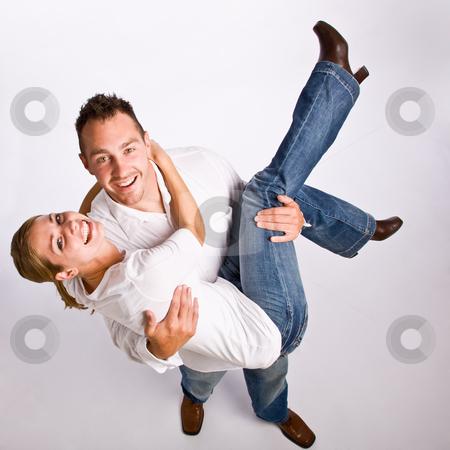 Boyfriend carrying girlfriend stock photo, Boyfriend carrying girlfriend by Jonathan Ross