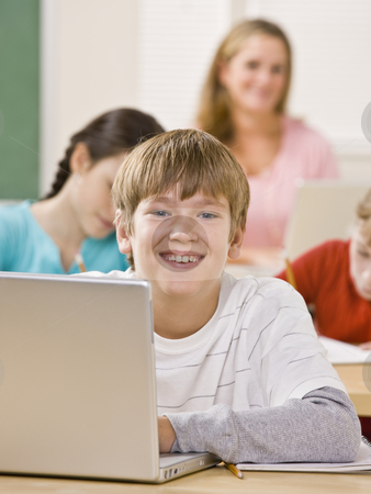 Student using laptop in classroom stock photo, Student using laptop in classroom by Jonathan Ross