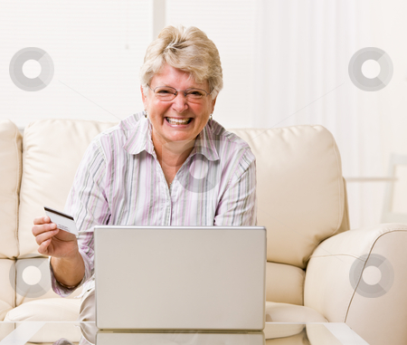 Woman using credit card to buy internet merchandise stock photo, Woman using credit card to buy internet merchandise by Jonathan Ross