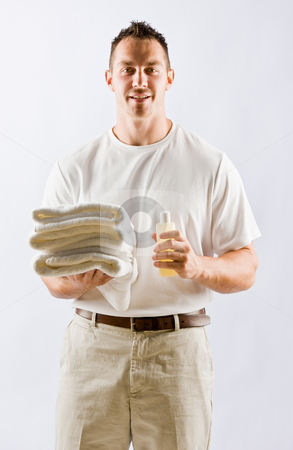 Massage therapist holding oil and towels stock photo, Massage therapist holding oil and towels by Jonathan Ross