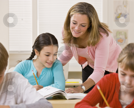 Teacher helping student in classroom stock photo, Teacher helping student in classroom by Jonathan Ross