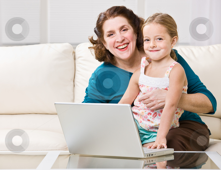 Grandmother and granddaughter using laptop stock photo, Grandmother and granddaughter using laptop by Jonathan Ross