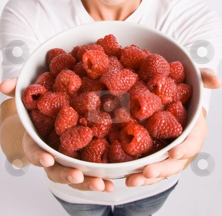 Woman holding bowl of raspberries stock photo, Woman holding bowl of raspberries by Jonathan Ross