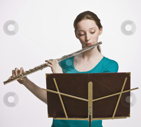 Teenage girl playing flute stock photo, Teenage girl playing flute by Jonathan Ross