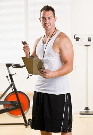 Personal trainer holding stop watch and clipboard stock photo, Personal trainer holding stop watch and clipboard by Jonathan Ross