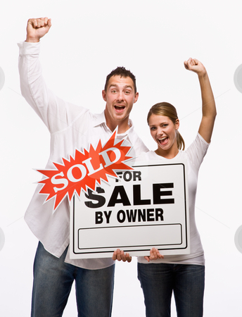 Couple cheering and holding for sale sign stock photo, Couple cheering and holding for sale sign by Jonathan Ross