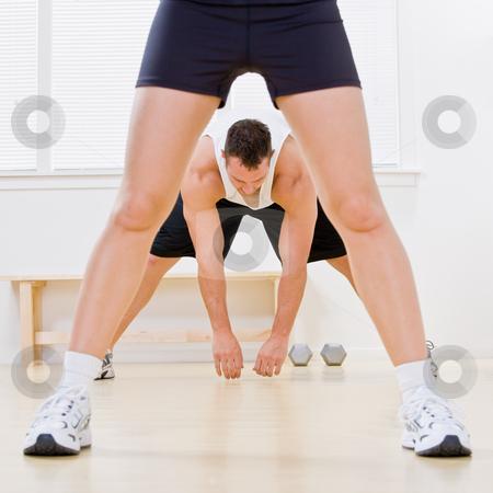 Man stretching in health club stock photo, Man stretching in health club by Jonathan Ross