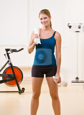 Woman exercising in health club stock photo, Woman exercising in health club by Jonathan Ross