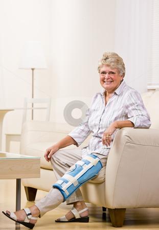 Senior woman wearing knee brace stock photo, Senior woman wearing knee brace by Jonathan Ross