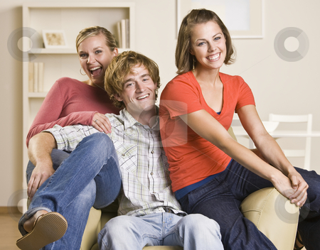 Friends sitting together in chair stock photo, Friends sitting together in chair by Jonathan Ross