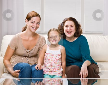 Three generation family sitting on sofa stock photo, Three generation family sitting on sofa by Jonathan Ross
