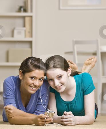 Teenage girls sharing mp3 player stock photo, Teenage girls sharing mp3 player by Jonathan Ross