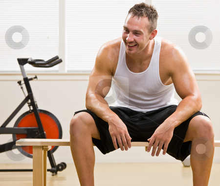 Man resting in health club stock photo, Man resting in health club by Jonathan Ross