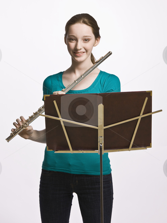 Teenage girl playing flute stock photo, Teenage girl playing flute by Jonathan Ross