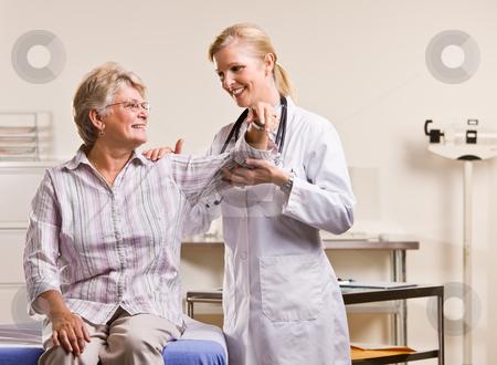 Doctor checking senior woman?s arm stock photo, Doctor checking senior woman?s arm by Jonathan Ross