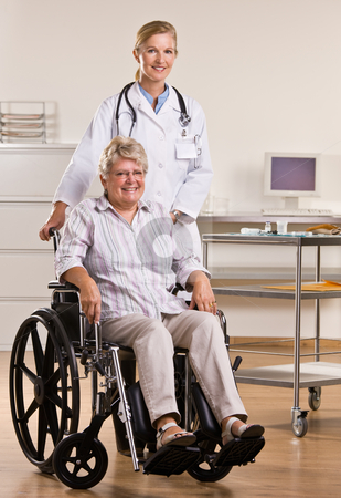 Senior woman sitting in wheelchair with doctor stock photo, Senior woman sitting in wheelchair with doctor by Jonathan Ross