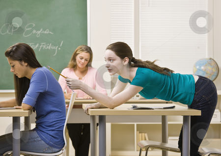 Student tapping classmate in classroom stock photo, Student tapping classmate in classroom by Jonathan Ross