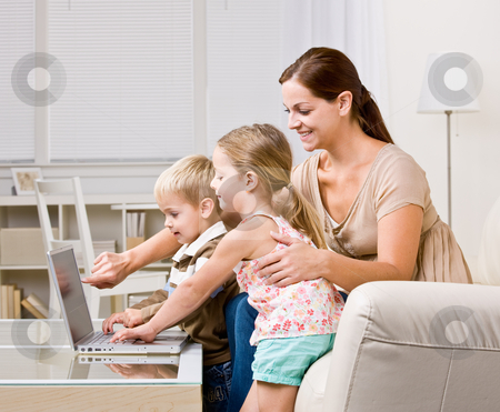 Mother showing children laptop stock photo, Mother showing children laptop by Jonathan Ross