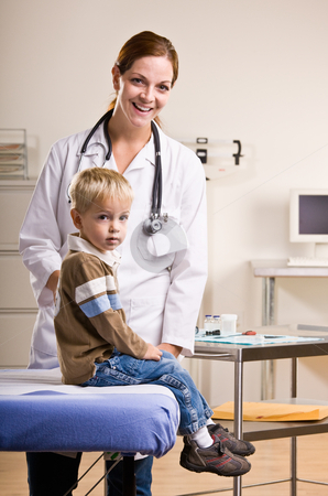 Doctor giving boy checkup in doctor?s office stock photo, Doctor giving boy checkup in doctor?s office by Jonathan Ross