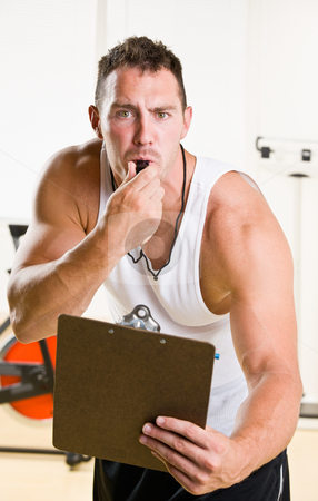 Personal trainer blowing whistle in health club stock photo, Personal trainer blowing whistle in health club by Jonathan Ross