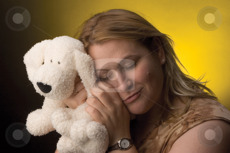 Women stuff animal stock photo, Wormn hugging a stuff dog by Yann Poirier