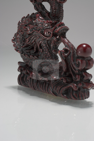 Floating dragon stock photo, Chinese dragon statue floating over a white surface by Yann Poirier