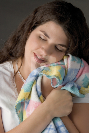 Women napping stock photo, Young adult women taking a nap on a baby blanket by Yann Poirier