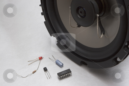 Speaker and chip stock photo, High tech speaker with low technologie part, LED, resistor, transistor and chip. by Yann Poirier