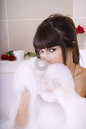 Woman in bobble bath stock photo, Woman in a jacuzzi is having fun with the foam by Daniel Kafer