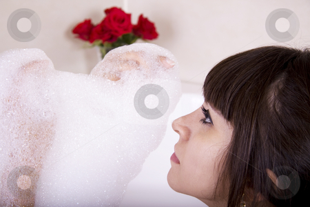 Jacuzzi foam stock photo, Woman in a jacuzzi playing with the foam by Daniel Kafer