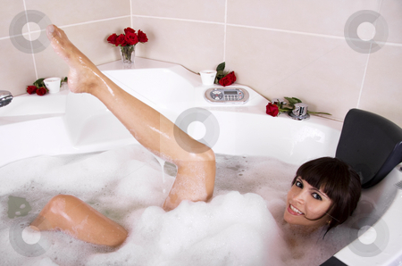 Woman in jacuzzi stock photo, Beautiful woman is having fun in a jacuzzi by Daniel Kafer