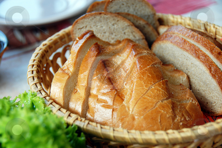 Bread stock photo, White bread slices served in wicker utensil served on table by Julija Sapic