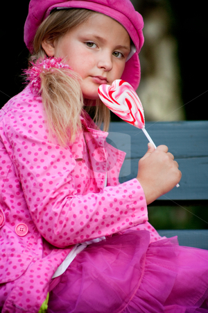 Arogant looking pink child stock photo, Happy children having pink clothes and a lollipop by Frenk and Danielle Kaufmann