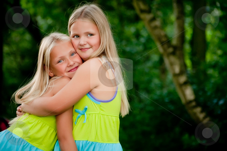 Hugging twins stock photo, Happy children having fun in the park by Frenk and Danielle Kaufmann