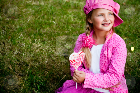 Cute little girl with lolly stock photo, Happy children having pink clothes and a lollipop by Frenk and Danielle Kaufmann