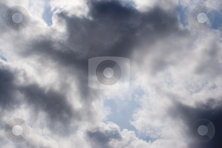 Dark cloud stock photo, Dark cloud on blue background by Yann Poirier