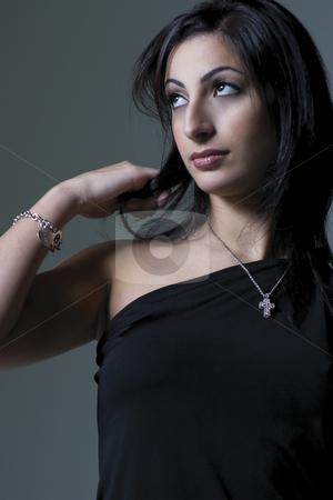 Fashion model stock photo, Fashion model in black dress, looking up by Yann Poirier