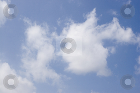 Puffy cloud stock photo, Puffyv cloud on blue background by Yann Poirier
