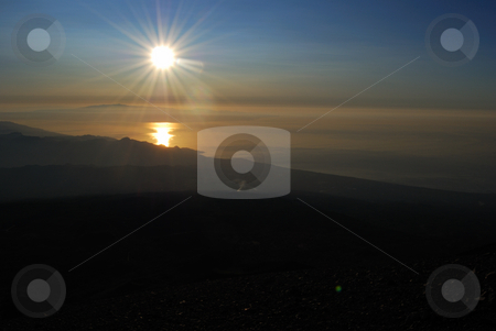 Sunrise From Etna stock photo, The image shows the sunrise at north of Sicily. At background there is Calabria and foreground Nebrodi and Taormina. by Antonino Sicali