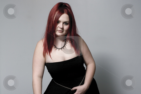Goth rock chick stock photo, Red hair female model looking down with goth look by Yann Poirier
