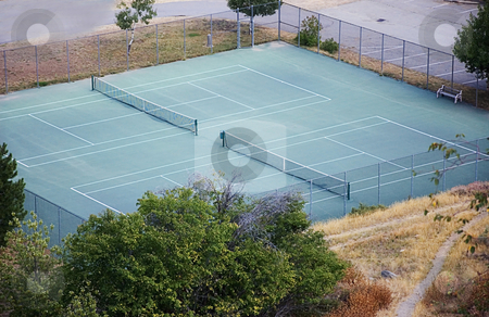 Tennis Courts stock photo, This photo is of two tennis courts in a mountain setting with the view of looking down upon them. by Valerie Garner