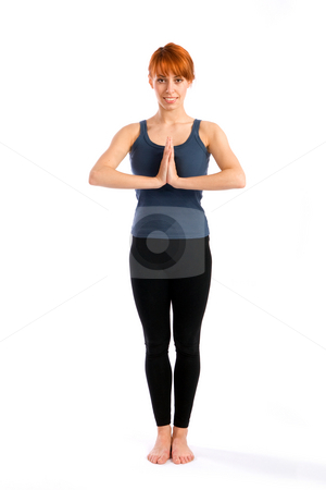 Attractive Woman Standing in Yoga Pose stock photo, Young attractive woman standing in Yoga pose, isolated over white background. by Rognar