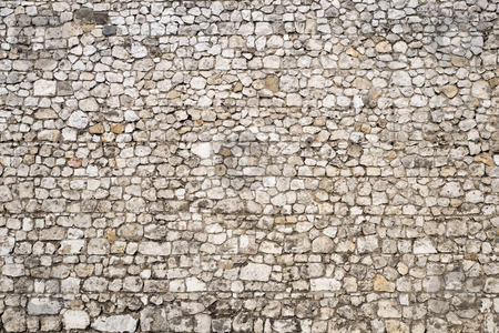 Medieval Stone Wall Backgound stock photo, Old stone wall background of the medieval castle. by Rognar