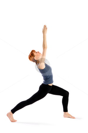 Woman doing Yoga Exercise stock photo, Woman doing yoga exercise called Virabhadrasana (warrior pose), isolated over white background. by Rognar