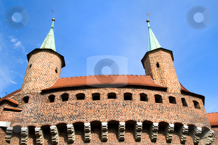 Great Barbican Monument in Cracow, Poland stock photo, Part of the 500-year-old fortification with three meters thick walls, once Europe's mightiest barbican in Cracow, Poland. by Rognar