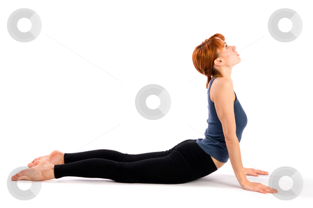 Woman Practising Yoga Asana stock photo, Young fit woman doing yoga exercise called Bhujangasana, isolated on white background. by Rognar