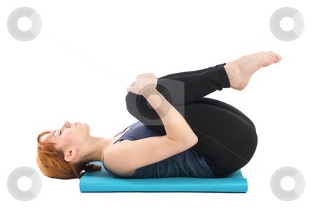 Yoga Exercise stock photo, Young female doing yoga exercise, isolated on white background. by Rognar