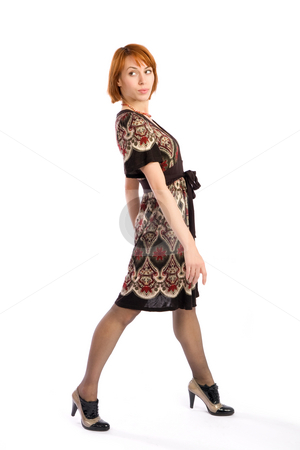 Young Attractive Woman stock photo, Young stylish attractive woman posing, isolated on white background. by Rognar