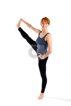 Slim Woman doing  Leg Stretching Yoga Exercise stock photo, Young fit woman doing yoga exercise called Utthita Hasta Padangusthasana, isolated on white background. by Rognar