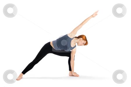Woman Practising Yoga Exercise stock photo, Woman doing yoga exercise called Parsvakonasana, isolated on white background. by Rognar
